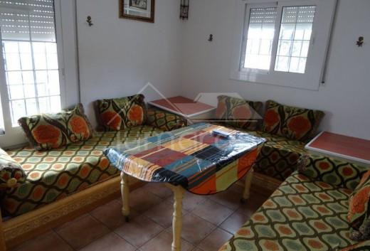Chambre 1 aménagé en petit salon